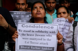 A woman holds a placard during a protest against Sunday's attack on an Indian army base in Indian-controlled Kashmir, in Mumbai, India, Tuesday, Sept. 20, 2016. (AP / Rafiq Maqbool)