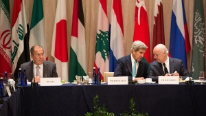 U.S. Secretary of State John Kerry, centre, sits with United Nations envoy to Syria, Staffan de Mistura, right, and Russian Foreign Minister Sergey Lavrov during the International Syria Support Group meeting in New York on Tuesday, Sept. 20, 2016. (AP / Kevin Hagen)