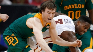 Baylor guard Brady Heslip, left, and Iowa State forward Melvin Ejim (3) chase a loose ball during the first half of an NCAA college basketball game in the final of the Big 12 Conference men's tournament in Kansas City, Mo., Saturday, March 15, 2014. The Toronto Raptors have signed free-agent guard Brady Heslip. (Orlin Wagner/THE CANADIAN PRESS/AP)