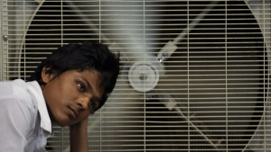 In this May 31, 2015 file photo, an Indian man rests in front of an air cooler to cool himself on a hot summer day in Hyderabad, in the southern Indian state of Telangana. (AP Photo/Mahesh Kumar A., File)