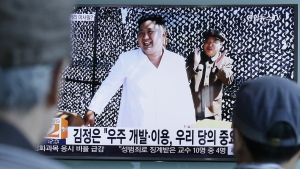 People watch a TV news program showing an image, published in North Korea's Rodong Sinmun newspaper, of North Korean leader Kim Jong Un at the country's Sohae Space Center, at Seoul Railway station in Seoul, South Korea, Tuesday, Sept. 20, 2016. (AP / Ahn Young-joon)