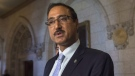 Infrastructure and Communities Minister Amarjeet Sohi speaks with the media in the Foyer of the House of Commons Tuesday September 20, 2016 in Ottawa. THE CANADIAN PRESS/Adrian Wyld