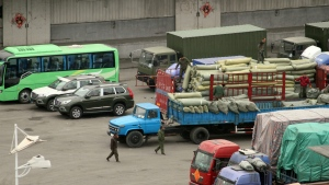 In this Thursday, March 17, 2016 photo, cargo trucks and other vehicles wait at a border checkpoint to cross into North Korea in Dandong in northeastern China's Liaoning Province. (Chinatopix via AP)