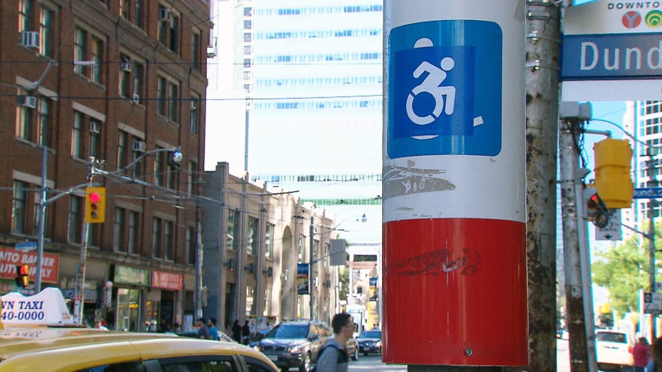 An proposed design to update the International Symbol of Access is shown on a sticker in downtown Toronto.