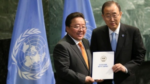 Mongolia President Tsakhiagiin Elbegdorj, left, poses for a picture with United Nations Secretary-General Ban Ki-moon during a ceremony to mark more signatories to the Paris climate accords at U.N. headquarters, Wednesday, Sept. 21, 2016. (AP Photo/Seth Wenig)