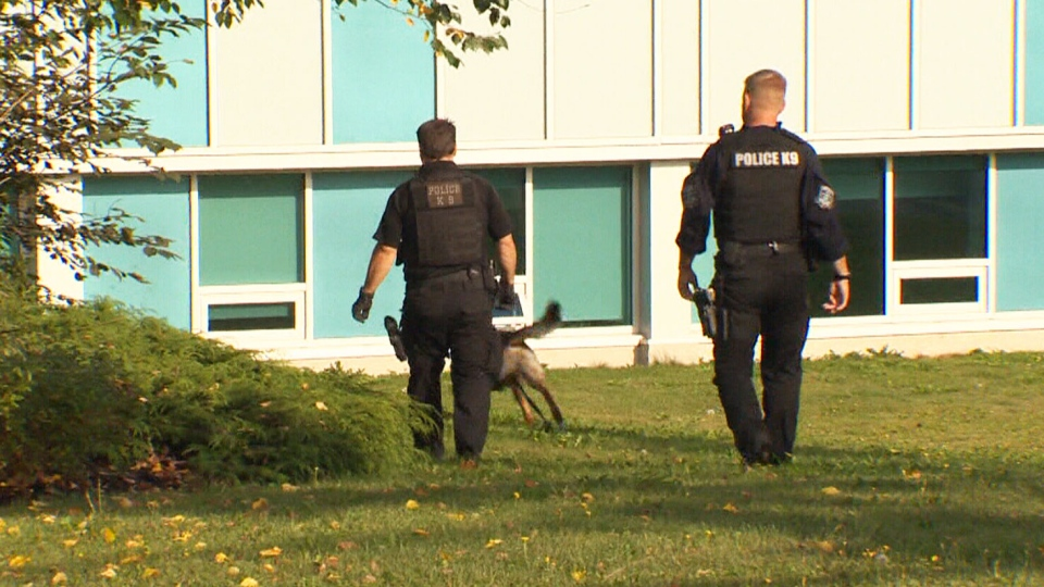 A police K9 unit searches one of three schools closed in Nova Scotia on Wednesday, Sept. 21, 2016. In a separate incident, all schools were evacuated in P.E.I. after RCMP received a bomb threat via fax Wednesday morning.