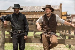 In this image released by Sony Pictures, Chris Pratt, right, and Denzel Washington appear in a scene from 'The Magnificent Seven.' (Sam Emerson)
