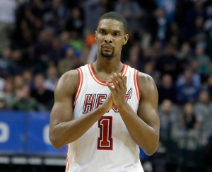 In this Feb. 3, 2016, file photo, Miami Heat forward Chris Bosh reacts to a call during the second half of an NBA basketball game against the Dallas Mavericks, in Dallas. (AP Photo/LM Otero)