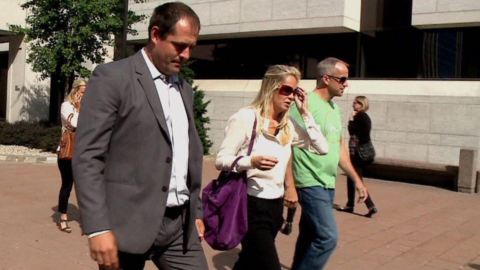 Former Ottawa Senators defenceman Chris Phillips leaves court with his wife Erin Phillips on Sept. 21, 2016.
