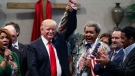 Boxing promoter Don King, right, holds up the hand of Republican presidential candidate Donald Trump during a visit to the Pastors Leadership Conference at New Spirit Revival Center, Wednesday, Sept. 21, 2016, in Cleveland, Ohio. (AP Photo/ Evan Vucci)