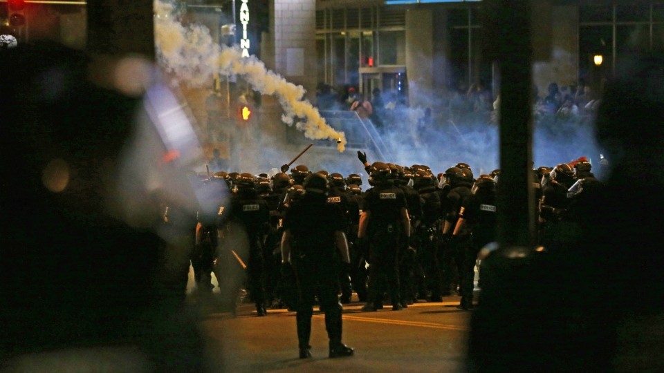 Police fire tear gas as protesters converge on downtown following Tuesday's police shooting of Keith Lamont Scott in Charlotte, N.C. on Wednesday, Sept. 21, 2016. (AP / Gerry Broome)