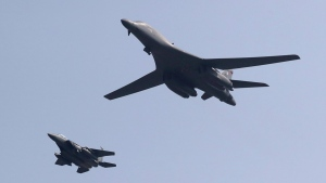 U.S. B-1B bomber, right, flies over Osan Air Base with a U.S. fighter jet in Pyeongtaek, South Korea, on Sept. 13, 2016. (Lee Jin-man / AP)