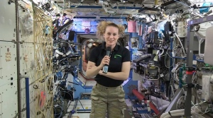 In this image from video made available by NASA, U.S. astronaut Kate Rubins speaks aboard the International Space Station during an interview on Thursday, Sept. 22, 2016.  (NASA via AP)