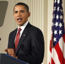U.S. President Barack Obama makes opening remarks during his first prime time televised news conference in the East Room of the White House in Washington, Monday, Feb. 9, 2009. (AP / Ron Edmonds)