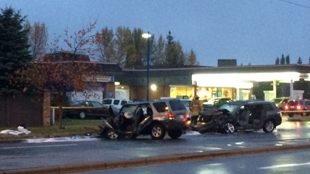 A damaged Ford Escape and a damaged Toyota Highlander in the northbound lanes of 24 St SW following Thursday night's crash