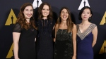 Presenter Daisy Ridley, second from left, poses with student Academy Award winners in the documentary category at the 43rd Annual Student Academy Awards at the Academy of Motion Picture Arts and Sciences in Beverly Hills, Calif. on Thursday, Sept. 22, 2016 (Chris Pizzello / Invision)