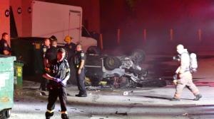 A car hit a wall, flipped on its roof and burst into flames after a road rage incident with a group of motorcycles on Sept. 22, 2016. (Pascal Marchand/CP24)
