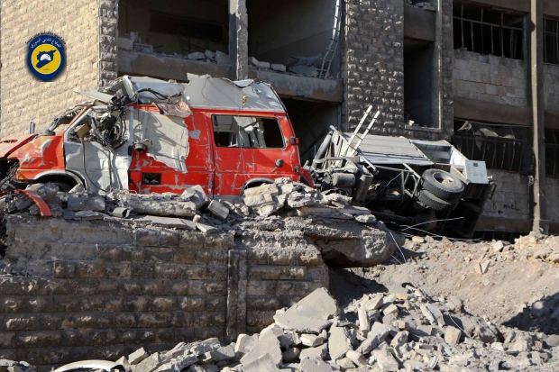 In this photo provided by the Syrian Civil Defense group known as the White Helmets, destroyed ambulances are seen outside the Syrian Civil Defense main centre after airstrikes in Ansari neighborhood in the rebel-held part of eastern Aleppo, Syria on Friday, Sept. 23, 2016. (Syrian Civil Defense White Helmets via AP)