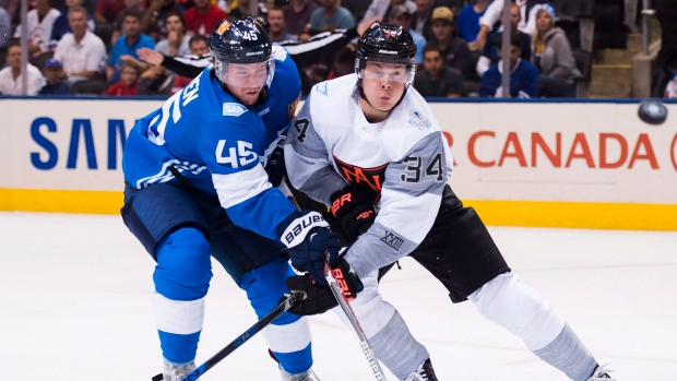 North America's Auston Matthews (34) battles for the puck against Finland's Sami Vatanen (45) during first period World Cup of Hockey action in Toronto on Sunday, September 18, 2016. First overall pick Matthews, who played pro hockey last season in Switzerland and is now on Team North America at the World Cup, is pretty much a lock to stick with the Toronto Maple Leafs.(Nathan Denette/The Canadian Press)