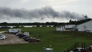 Smoke rises from a SpaceX launch site, at Cape Canaveral, Fla., Thursday, Sept. 1, 2016. (AP Photo/Marcia Dunn)