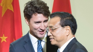 Prime Minister Justin Trudeau, left, introduces Chinese Premier Li Keqiang after speaking to a business luncheon, in Montreal, on Friday, Sept. 23, 2016. (THE CANADIAN PRESS/Ryan Remiorz)