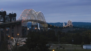 Lights illuminate the International Bridge in Sault Ste. Marie, Ont., on Wednesday, Aug. 12, 2015. (Angela Kipling/The Evening News via AP)
