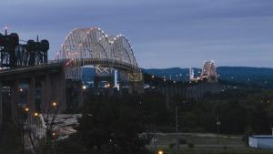Lights illuminate the International Bridge in Sault Ste. Marie, Ont., on Wednesday, Aug. 12, 2015. (Angela Kipling/The Evening News via AP)