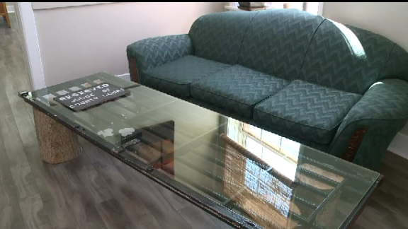 Smith has converted an old cell door into a glass coffee table.