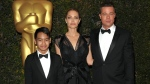 In this Nov. 16, 2013 file photo, Maddox Jolie-Pitt, from left, Angelina Jolie and Brad Pitt attend the 2013 Governors Awards in Los Angeles. Jolie Pitt filed for divorce from her husband on Sept. 19, 2016, demanding sole physical custody of their six children. (Photo by John Shearer / Invision / AP, File)