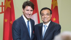 Chinese Premier Li Keqiang, and Canadian Prime Minister Justin Trudeau shake hands after speaking to a business luncheon Friday, September 23, 2016 in Montreal. (THE CANADIAN PRESS / Ryan Remiorz)