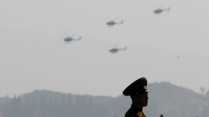 A North Korean military soldier stands guard as Hughes MD-500 helicopters fly past during an aerial display in Wonsan, North Korea on Saturday, Sept. 24, 2016. (AP / Wong Maye-E)