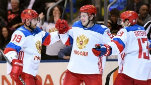 Team Russia's Andrei Markov (79) and Pavel Datsyuk (13) congratulate Vladimir Tarasenko (91) on his goal during second period World Cup of Hockey action against Team North America in Toronto on Monday, September 19, 2016. THE CANADIAN PRESS/Frank Gunn