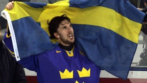 FILE - In this Feb. 26, 2006 file photo, Sweden's goaltender Henrik Lundqvist celebrates with his nations flag after defeating Finland 3-2 in the gold medal ice hockey match at the 2006 Turin Winter Olympic Games in Turin, Italy. (AP Photo/Eric Risberg)