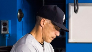 New York Yankees manager Joe Girardi looks down as his team plays the Toronto Blue Jays during the eighth inning of MLB baseball action in Toronto, Friday September 23, 2016. (Mark Blinch/The Canadian Press)
