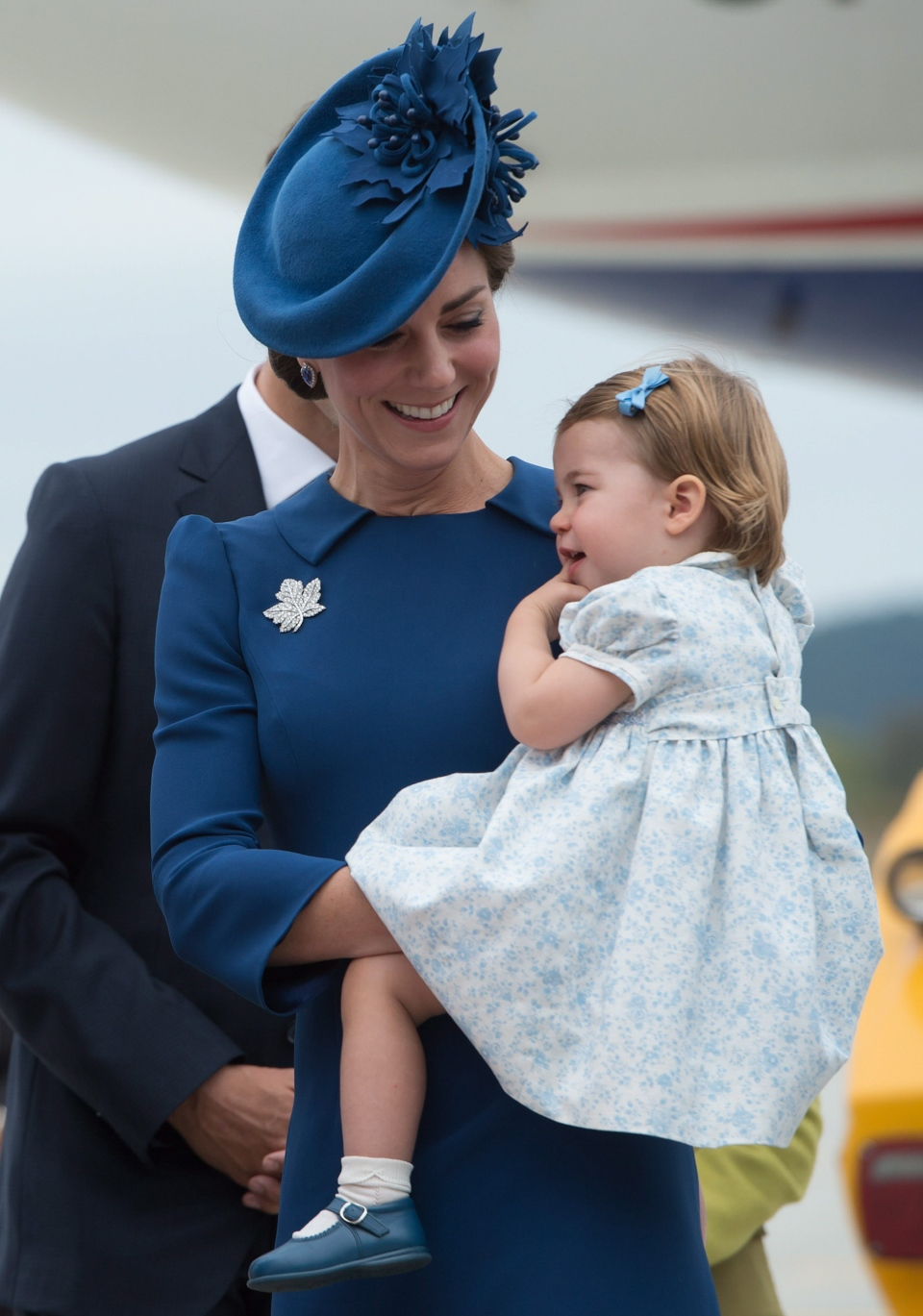 The Duchess of Cambridge holds her daughter Princess Charlotte as she and The Duke of Cambridge and their son Prince George arrive in Victoria, B.C., on Saturday, September 24, 2016. (THE CANADIAN PRESS / Jonathan Hayward)