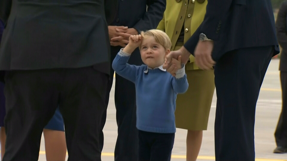Prince George holds his parents' hands on the tarmac in Victoria, B.C.