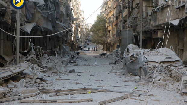 In this photo provided by the Syrian Civil Defense group known as the White Helmets, shows heavily damaged buildings after airstrikes hit in Aleppo, Syria, Saturday, Sept. 24, 2016. (Syrian Civil Defense White Helmets via AP)