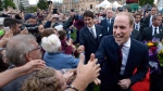The Duke of Cambridge greets onlookers with Prime Minister Justin Trudeau in front of the Legislative Assembly in Victoria, B.C., on Saturday, September 24, 2016. (THE CANADIAN PRESS / Jonathan Hayward)