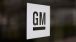 This file photo shows the General Motors logo at the company's world headquarters in Detroit on May 16, 2014. (AP Photo/Paul Sancya, File)