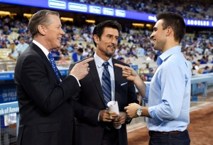 In this Monday, Sept. 19, 2016 photo Dodgers broadcasters, from left, Orel Hershiser, Nomar Garciaparra and Joe Davis chat prior to a baseball game between the Los Angeles Dodgers and the San Francisco Giants, in Los Angeles. (AP / Mark J. Terrill)