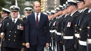 Prince William, the Duke of Cambridge, inspects an honor guard of members of the Royal Canadian Navy in front of the Legislative Assembly in Victoria, British Columbia, on Saturday, Sept. 24, 2016. (Jonathan Hayward/The Canadian Press via AP)