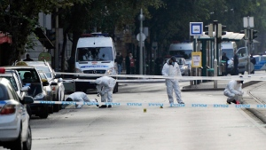 Police forensic experts examine the scene in central Budapest, Hungary, Sunday, Sept. 25, 2016, after an explosion of yet unknown origin occured in a shop late Saturday night. (Peter Lakatos/MTI via AP)