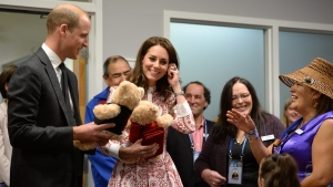 The Duke and Duchess of Cambridge receive teddy bears from five-year-old Hailey Cain during a tour of Sheway, a centre that provides support for native women, in Vancouver, B.C., Sunday, Sept. 25, 2016. THE CANADIAN PRESS/Jonathan Hayward