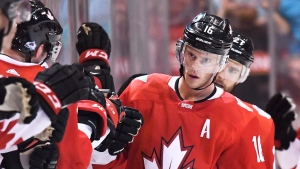 Team Canada's Jonathan Toews celebrates his second goal of the game against Team Europe with teammates on the bench during second period World Cup of Hockey action in Toronto on Wednesday, September 21, 2016. (THE CANADIAN PRESS/Frank Gunn)