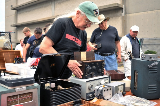 In this Sept. 18, 2016, photo, vendor Chuck Ochs shows a 1921 Crosley Model 51 radio, priced at $100, at MIT's Radio Society flea market on the campus of the Massachusetts Institute of Technology in Cambridge, Mass. (AP Photo/Collin Binkley)