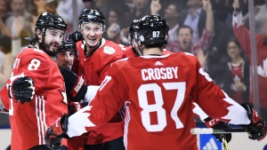 Team Canada's Brad Marchand (63), centre left, celebrates his goal against Team Russia with teammates Drew Doughty (8), Team Canada's D Jay Bouwmeester (4) and Sidney Crosby (87) during third period World Cup of Hockey semifinal action in Toronto on Saturday, September 24, 2016. THE CANADIAN PRESS/Nathan Denette