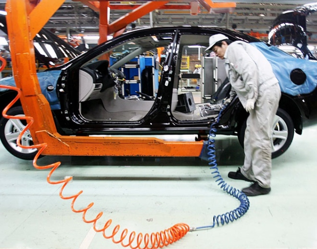 A worker works on a production line of sedans at an auto factory of China's First Automotive Works Group Corporation in Changchun, northeast China's Jilin province on Jan. 21, 2009. (AP / Color China Photo)