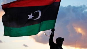 A Libyan waves the national flag in Benghazi, Libya, on Feb, 15, 2013. (Mohammad Hannon / AP)