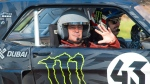 Actor and Top Gear presenter Matt LeBlanc, left, waves, as he sits with rally driver Ken Block during filming of BBC Top Gear in Westminster, London on Sunday Sunday March 13, 2016. (Dominic Lipinski / PA via AP)