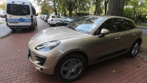 A Porsche car on Moscow registration plates parked near the office of Prime Minister Beata Szydlo in Warsaw, Poland, Monday, Sept. 26, 2016, shortly after its driver, a Russian citizen, was detained by the police for illegally flying a drone over the government and president's buildings. The car was later escorted away by the police. (Czarek Sokolowski/AP)